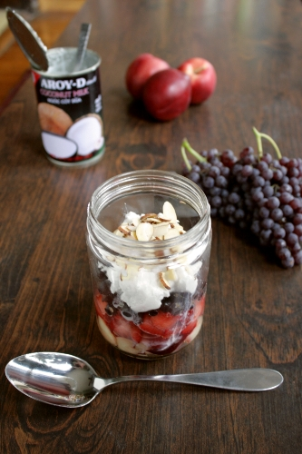 layered fruit salad with whipped coconut cream